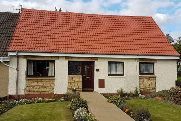cream render and red roof tiles